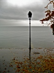This lampost strangely situated by itself on the edge of the water seemed strangely fitting